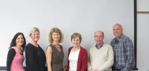 The management team & honorary management professor Laura Bowyer